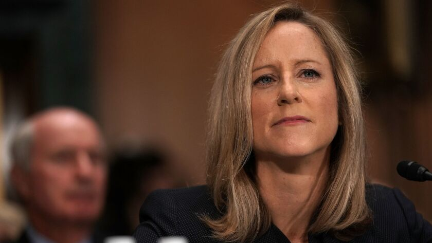 Kathy Kraninger, President Trump's nominee to head the Consumer Financial Protection Bureau, testifies during her Senate Banking Committee confirmation hearing in July.