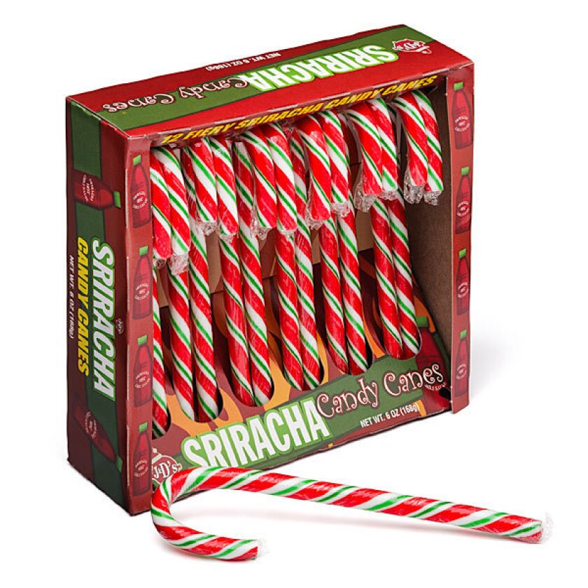 Sriracha candy canes by J&D Foods. Serve them over ice cream or use them as a holiday cocktail stirrer.