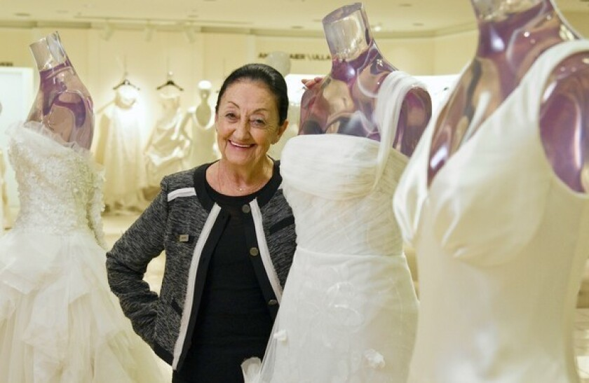 Bride whisperer matches wedding gowns and wearers