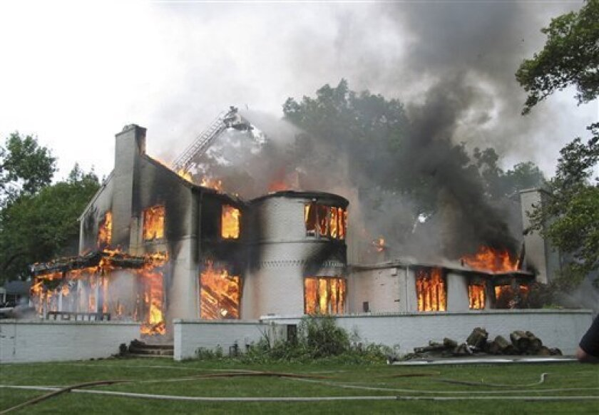 A 2004 file photo provided by The Upper Arlington, Ohio Fire Department shows the Upper Arlington home donated by ESPN college football commentator Kirk Herbstreit that was intentionally burned during a training exercise by the local fire department. The former Ohio State football star's claim of