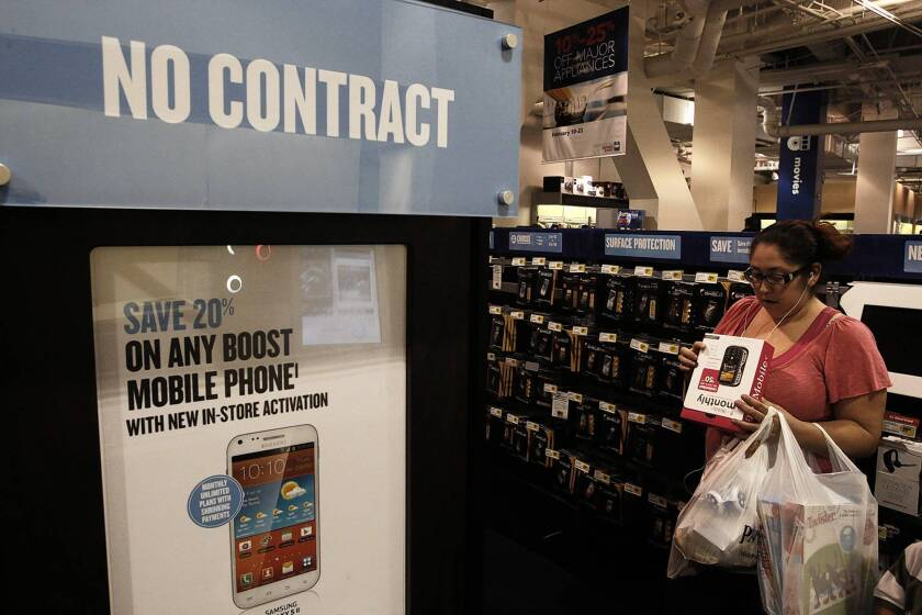 Adriana Valasquez shops for a prepaid, no-contract cellphone at Best Buy in Culver City recently.
