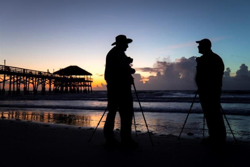 Ken Southworth (L) and Ben Oliva (R) photograph the sunrise behind Cocoa Beach Pier in Cocoa Beach, Florida, USA, 31 August 2019. EFE/EPA/JIM LO SCALZO