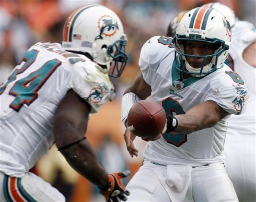 Miami Dolphins quarterback Pat White, right, hands off to running back Ricky Williams during the second half of an NFL football game against the Pittsburgh Steelers, Sunday, Jan. 3, 2010, in Miami. (AP Photo/J Pat Carter)