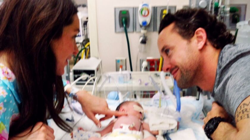 Nicole and Brent Gleeson with their daughter, Parker Rose, when she was an infant in the NICU.