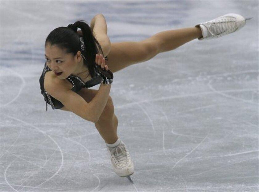 Akiko Suzuki of Japan performs during the women short program event at the ISU Four Continents Figure Skating Championships in Osaka, western Japan, Saturday, Feb. 9, 2013. (AP Photo/Shizuo Kambayashi)