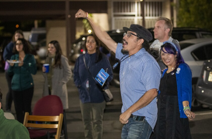 Joesé Hernandez, center, of Santa Ana previously volunteered with Bernie Sanders' 2016 campaign. He and other longtime activists were crucial to the senator's 2020 triumph in California.