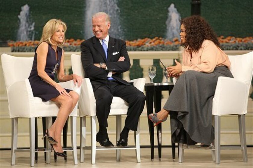 """This image provided by Harpo Productions shows, from left: Dr. Jill Biden, Vice President-elect Joe Biden, and Oprah Winfrey on the set of the """"Oprah Winfrey Show"""" at Washington's Kennedy Center Opera House Monday, Jan. 19, 2009. (AP Photo/Harpo Productions, Inc. George Burns)"""