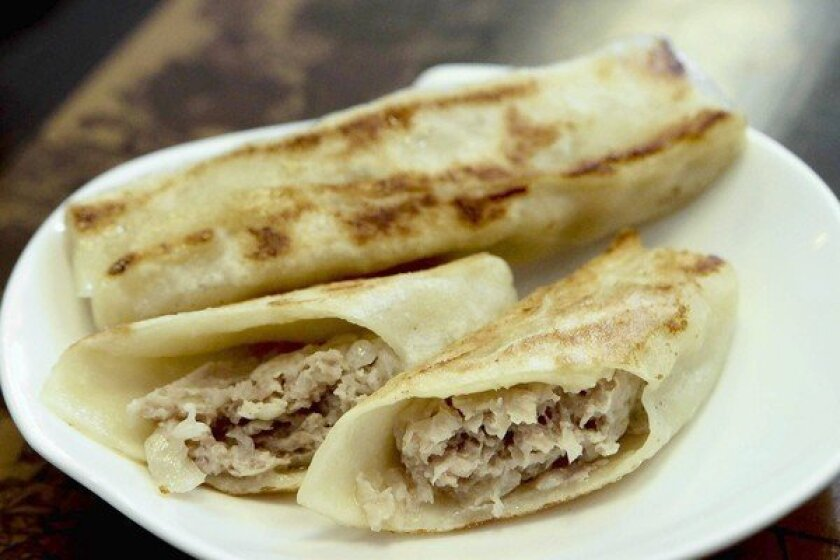 Hui tou are the signature dish, a sort of Chinese blintz filled with pork (and pork juices x{2014} be sure to put a napkin on your lap).