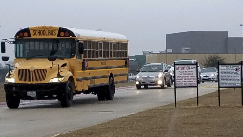 Signs alert those approaching Argyle High School in Argyle, Texas that staff are armed.