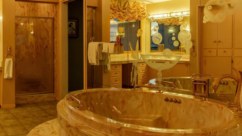 A marble bathtub with gold fixtures is an eye-catcher in one of the bathrooms in the Gaughan suite.