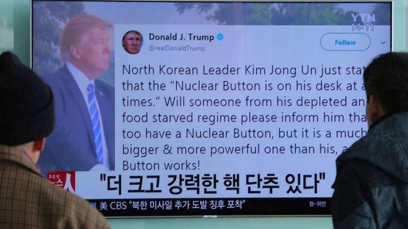 "People in Seoul watch a TV news program on Jan. 3 showing a tweet by President Trump about his ""nuclear button."""