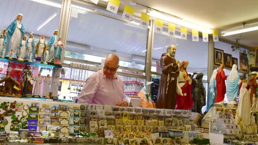 Bernard Byrne at work inside his souvenir shop in Knock, a pilgrimage site in the west of Ireland wh
