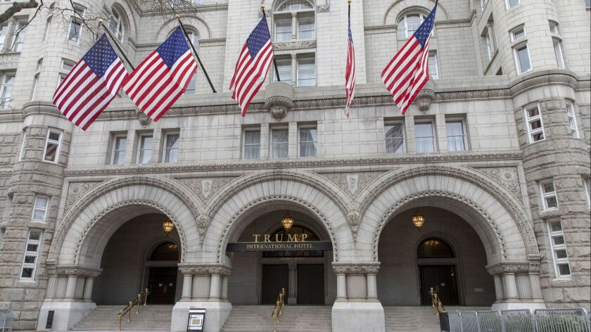 The day after T-Mobile announced a $26-billion merger with Sprint, nine of its executives -- including CEO John Legere -- had reservations at the Trump International Hotel in Washington.