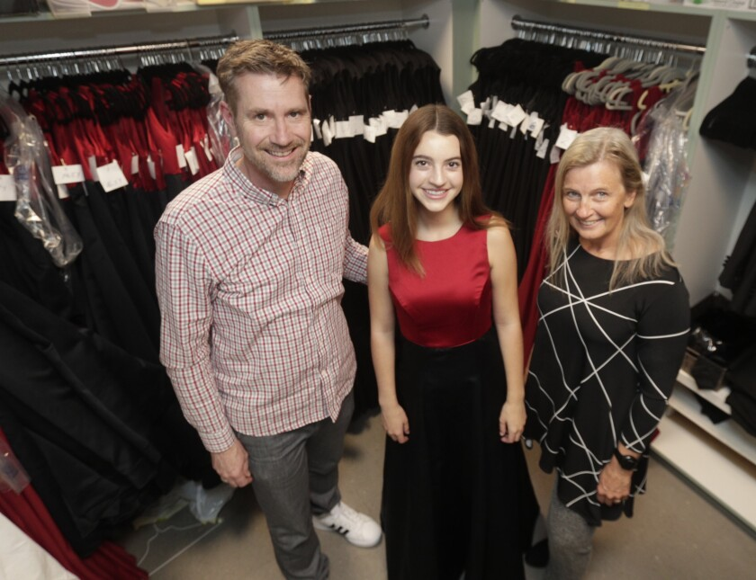 LCHS choir undergoes wardrobe change, donates dresses to district in need