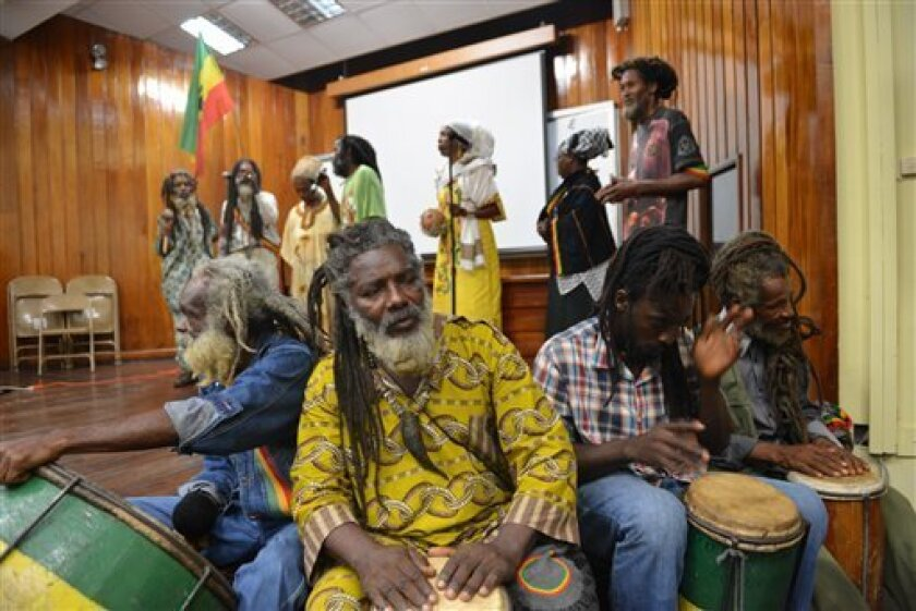 Rastafarians drum and chant during a weeklong conference and general assembly at the University of the West Indies in Kingston, Jamaica, Tuesday, Aug. 13, 2013. Rastafarians are gathering to brainstorm ways of pressuring European countries to pay reparations for slavery and other core beliefs of the spiritual movement. Rastafarians have long pushed for slavery reparations, a key tenet of their movement. They have unsuccessfully petitioned Britain to make amends. (AP Photo/David McFadden)
