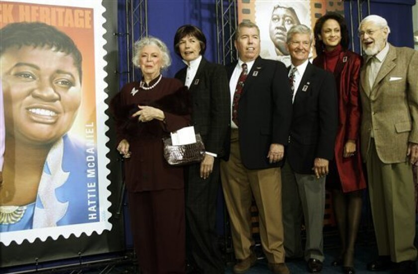 """FILE - In this Jan. 25, 2006 photo, Ann-Marie Johnson, National First Vice President of the Screen Actors Guild second from right, joins Gone With the Wind cast, from left: Ann Rutherford, Cammie King Conlon, Mickey Kuhn, Patrick Curtis and Fred Crane to celebrate actress Hattie McDaniel's stamp, seen at left, at the Margaret Herrick Library of the Academy of Motion Picture Arts and Sciences in Beverly Hills, Calif. Cammie King Conlon, the former child actress who portrayed the doomed daughter of Rhett Butler and Scarlett O'Hara in """"Gone With the Wind,"""" has died at the age of 76. She died of lung cancer Wednesday morning at her Fort Bragg home on California's north coast, said friend Bruce Lewis. Her son, Matthew Ned Conlon, was by her side. (AP Photo/Damian Dovarganes)"""