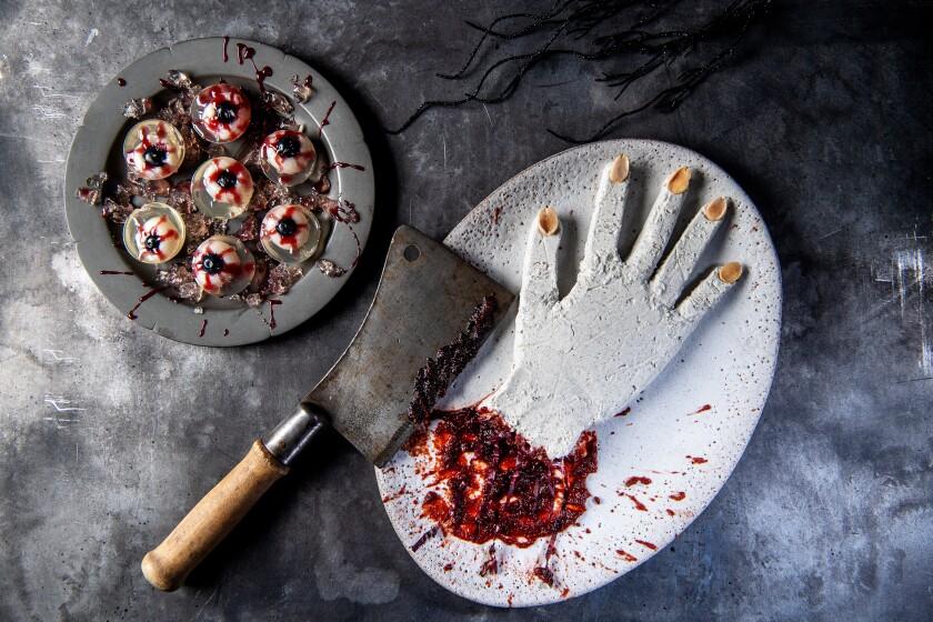 Dismembered goat cheese hand in beet-blood orange splatter