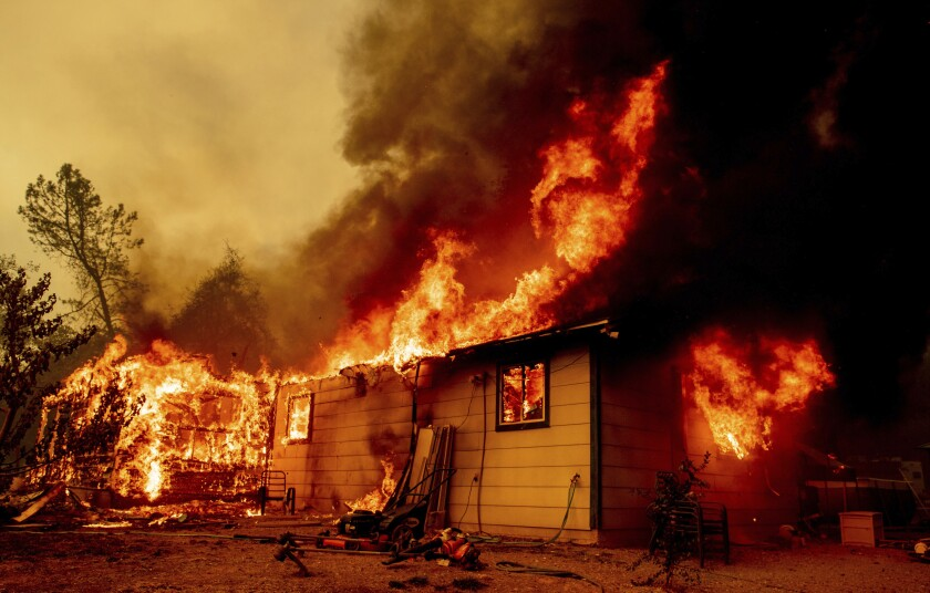 Flames consume a house near Old Oregon Trail in Shasta County, Calif.