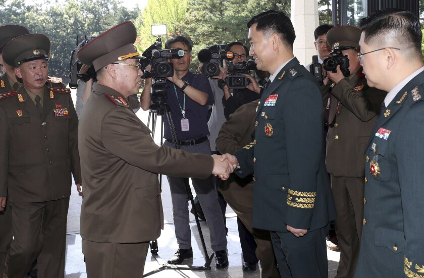 North Korean Lt. Gen. An Ik San, center left, shakes hands with his South Korean counterpart Maj. Gen. Kim Do-gyun upon his arrival at the Peace House at the border village of Panmunjom, South Korea, Tuesday, July 31, 2018.