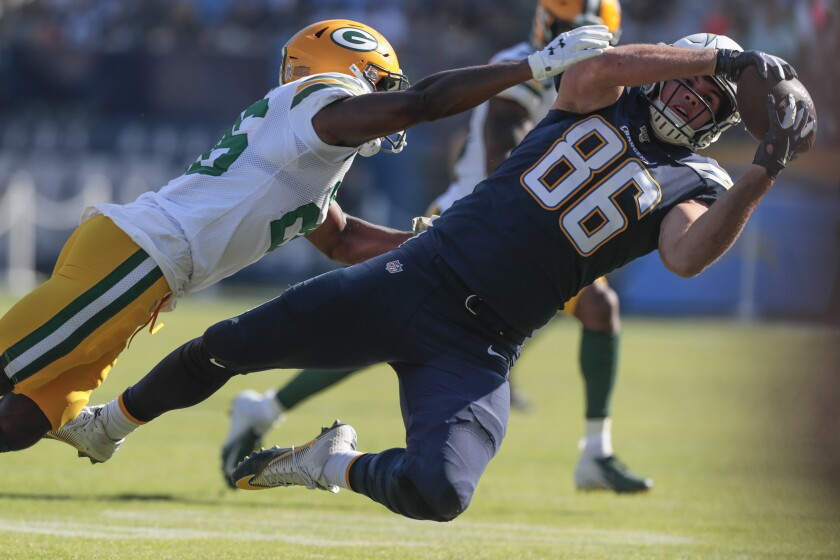 Chargers tight end Hunter Henry makes a catch while covered by Packers defensive back Darnell Savage during a game Nov. 3, 2019, at Dignity Health Sports Park.