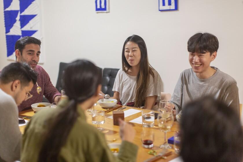 Guests enjoy artist Michelle Lee's art pop-up dinner, Sung