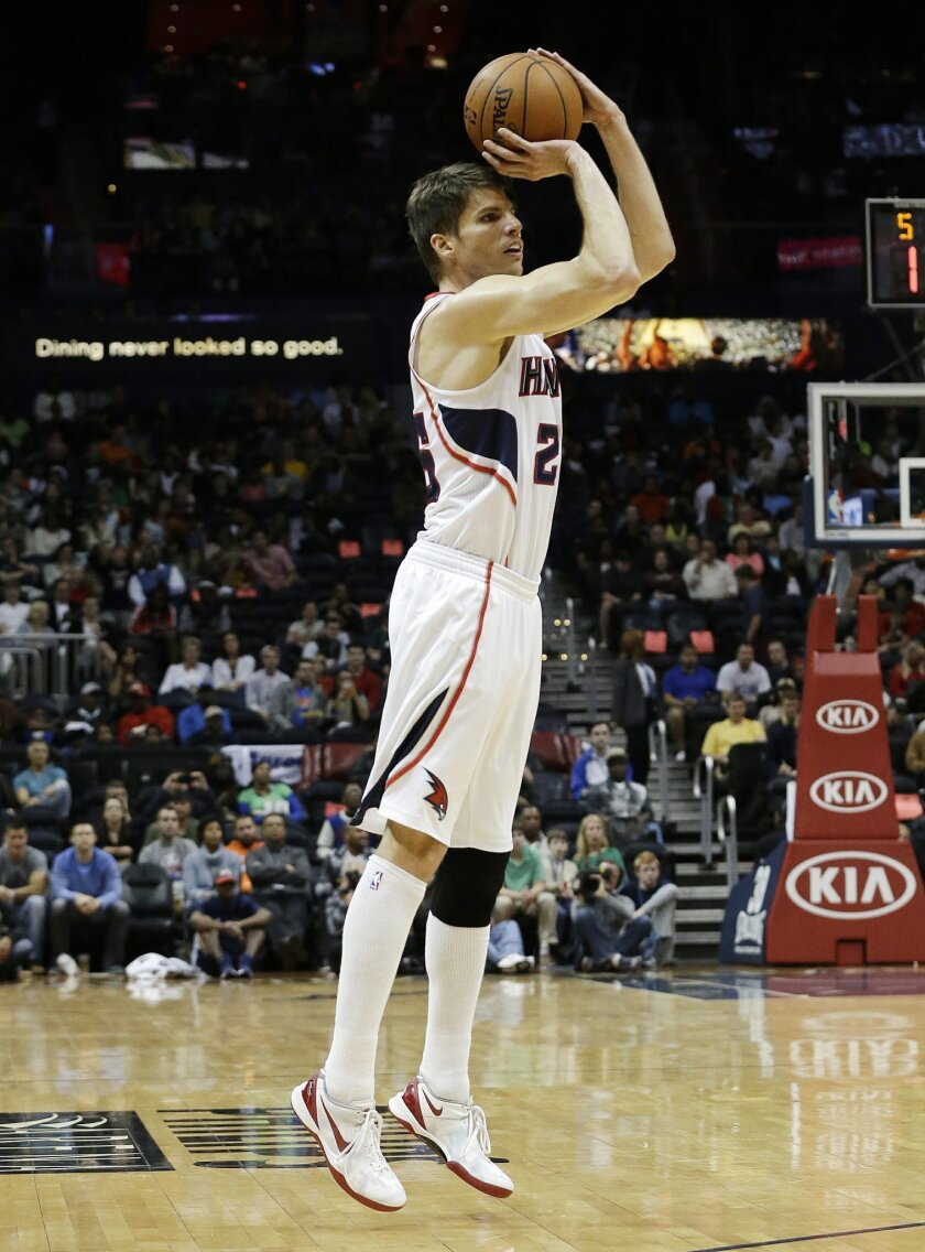 Atlanta Hawks' Kyle Korver sinks a three-point basket in the first half of an NBA basketball game against the Cleveland Cavaliers to break the NBA record for most consecutive games with a three pointer Friday, Dec. 6, 2013, in Atlanta. The old record was 89 straight games held by Dana Barros. (AP Photo/John Bazemore)