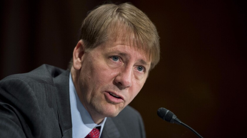 Richard Cordray, director of the Consumer Financial Protection Bureau, testifies before the Senate Banking, Housing and Urban Affairs Committee in 2015.