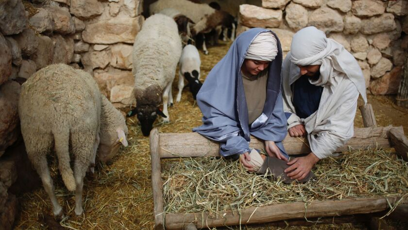 Christian actors portray Joseph and Mary during a re-enactment of a Nativity scene of the birth of J