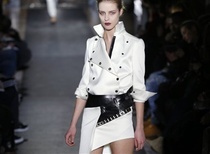A model wears a creation by Belgian designer Anthony Vaccarello as part of the Ready to wear Fall/Winter 2013/2014 fashion collection presented in Paris, Tuesday, Feb. 26 2013. (AP Photo/ Jacques Brinon)
