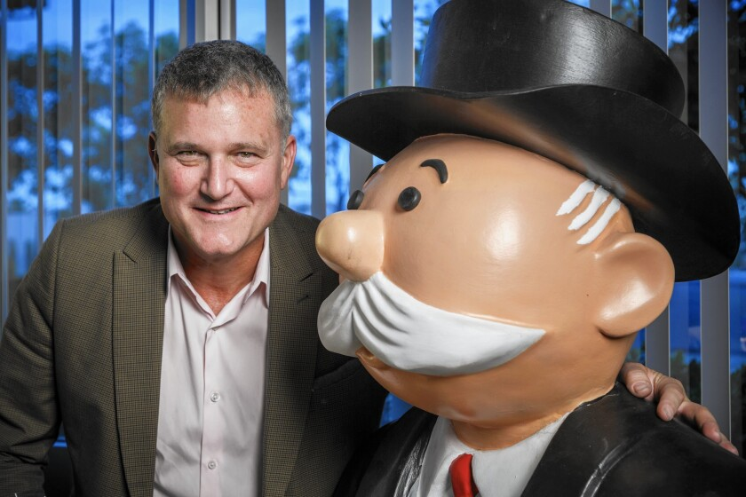 Hasbro Studios President Stephen Davis with a Mr. Monopoly figure at the company's headquarters in Burbank.