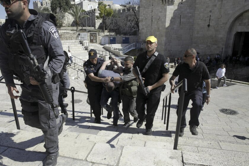 Israeli border police arrests a Palestinian at the Old City's Damascus Gate in Jerusalem Friday, Feb. 19, 2016. The Damascus Gate has been the scene of numerous Palestinian attacks over the past few months and Israel has significantly beefed up security in the area in response.(AP Photo/Mahmoud Ill