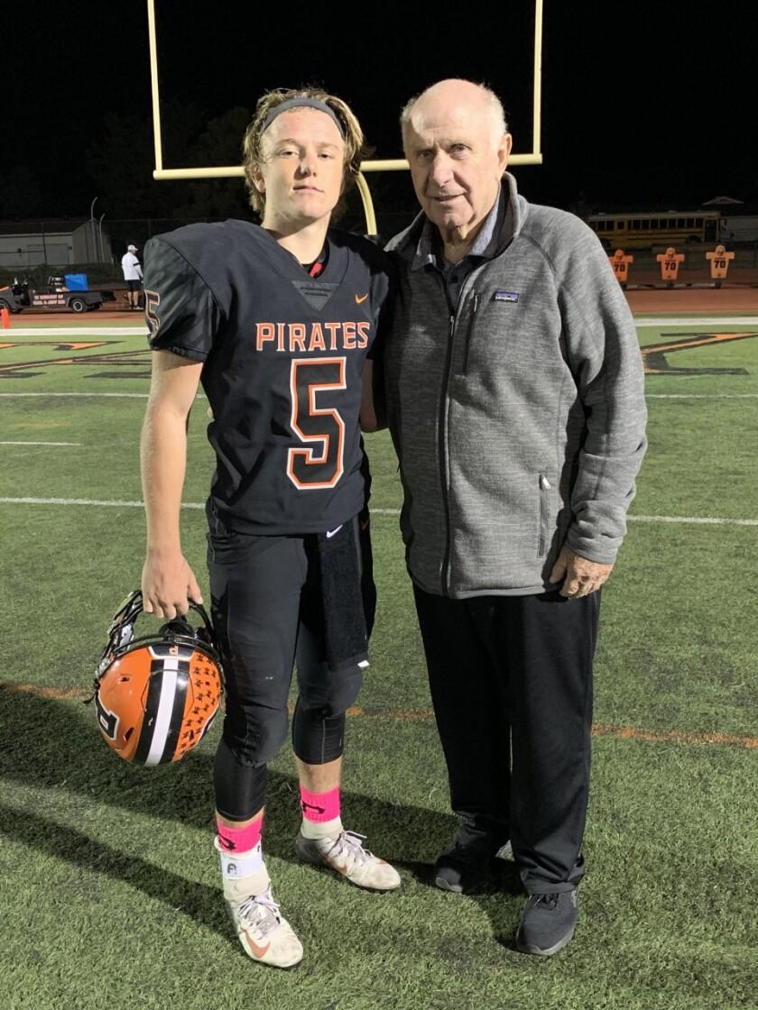 Santa Ynez quarterback Bennett Redell with his grandfather, former Oaks Christian coach Bill Redell.