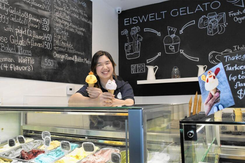 Owner Vyvy Hoang, 22, at her store, Eiswelt Gelato, in Westminster. Eiswelt is German for Ice World. Hoang was born in Germany.