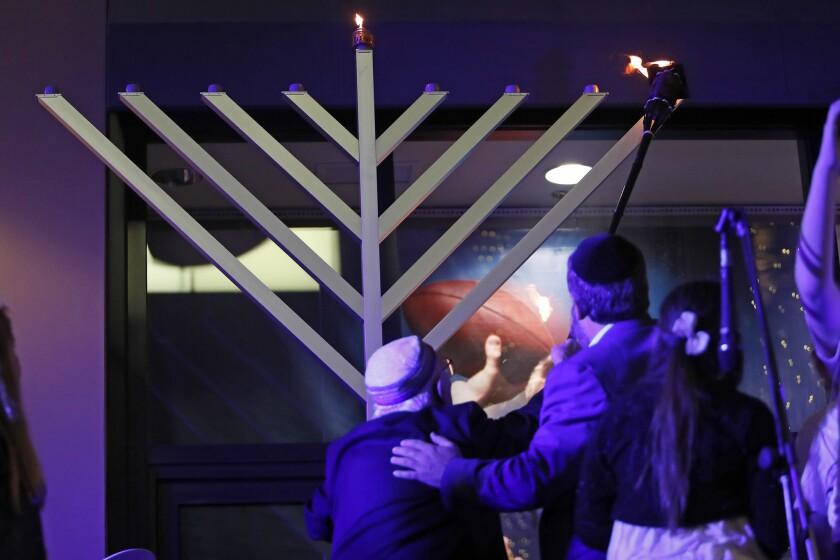 Dr. Jacob Eisenbach, left, a 93-year-old Holocaust survivor, center, and Rabbi Reuven Mintz, with th