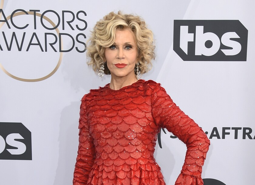 FILE - This Jan. 27, 2019 file photo shows Jane Fonda at the 25th annual Screen Actors Guild Awards in Los Angeles. Fonda was arrested at the U.S. Capitol on Friday, Oct. 11, while peacefully protesting climate change. The actress and activist was handcuffed on the east side steps and escorted into a police vehicle. Video of the arrest circulated online. (Photo by Jordan Strauss/Invision/AP, File)