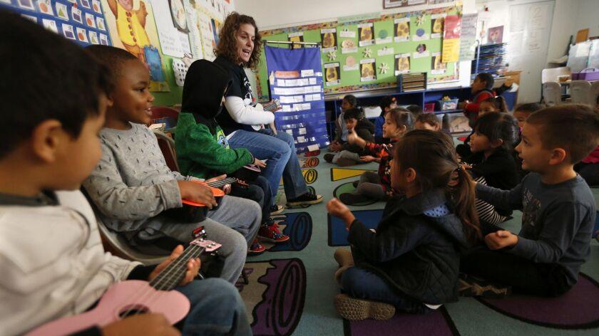 "LOS ANGELES, CA - JANUARY 26, 2016 -- Teacher Hillary Erlich, center, sings, ""Buenos Dias,"" (Good"