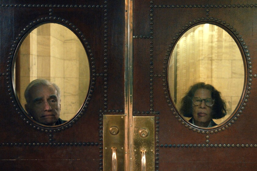 """Fran Lebowitz  and Martin Scorsese peek out through door windows in """"Pretend It's a City."""""""