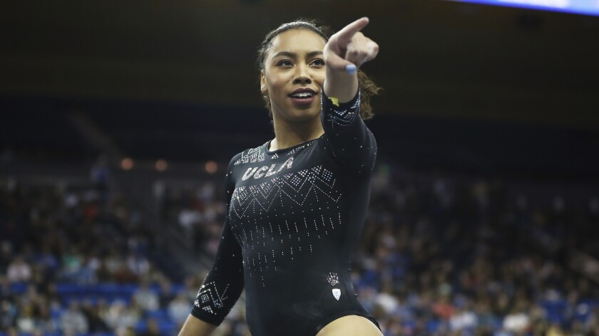 Margzetta Frazier points to the sideline during a gymnastics.