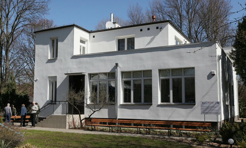 This photo from Thursday, April 9, 2015, shows a villa on the grounds of the Warsaw Zoo where dozens of Jews were sheltered during World War II, in Warsaw, Poland. On Saturday April 11 a permanent exhibition will be inaugurated remembering the wartime zoo director, Jan Zabinski and his wife, Antonina, who hid Jews in the basement of thee house and in animal enclosures. (AP Photo/Czarek Sokolowski)