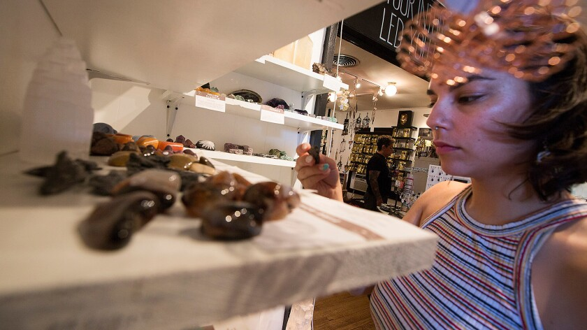 Rae Dalere of L.A. looks over crystals at the House of Intuition in Echo Park.