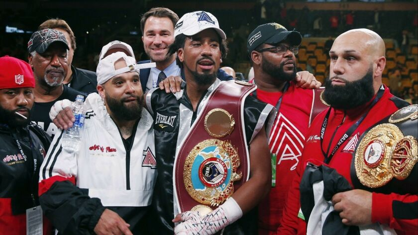 Demetrius Andrade, center, stands with members of his team after defeating Walter Kautondokwa in a WBO middleweight championship boxing match in October.