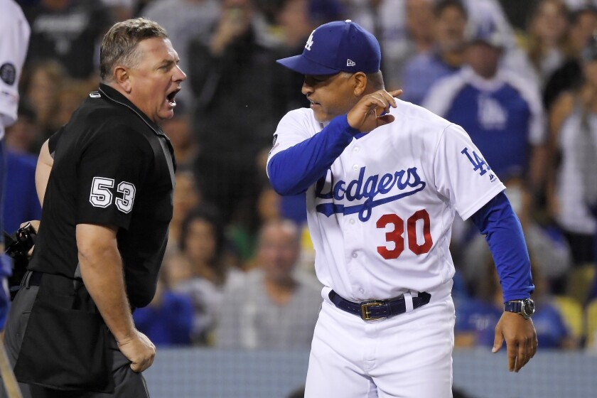 Dodgers manager Dave Roberts argues with umpire Greg Gibson after being ejected Sept. 20, 2019.