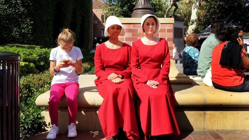"""Actresses in costume and character from the Hulu series """"The Handmaid's Tale,"""" based on the book by"""