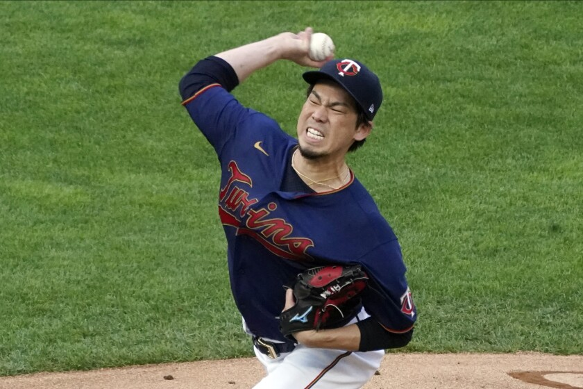 Minnesota Twins pitcher Kenta Maeda throws to a Detroit Tigers batter during the first inning of a baseball game Friday, July 9, 2021, in Minneapolis. (AP Photo/Jim Mone)