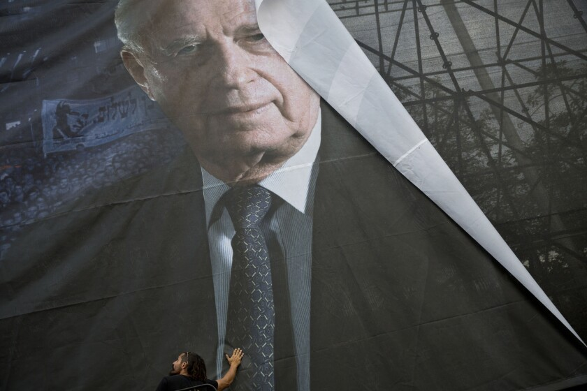 A portrait of late Israeli Prime Minister Yitzhak Rabin in Tel Aviv, Israel on Oct. 28. In 1995, Rabin was assassinated by a right-wing Israeli minutes after attending a festive peace rally.