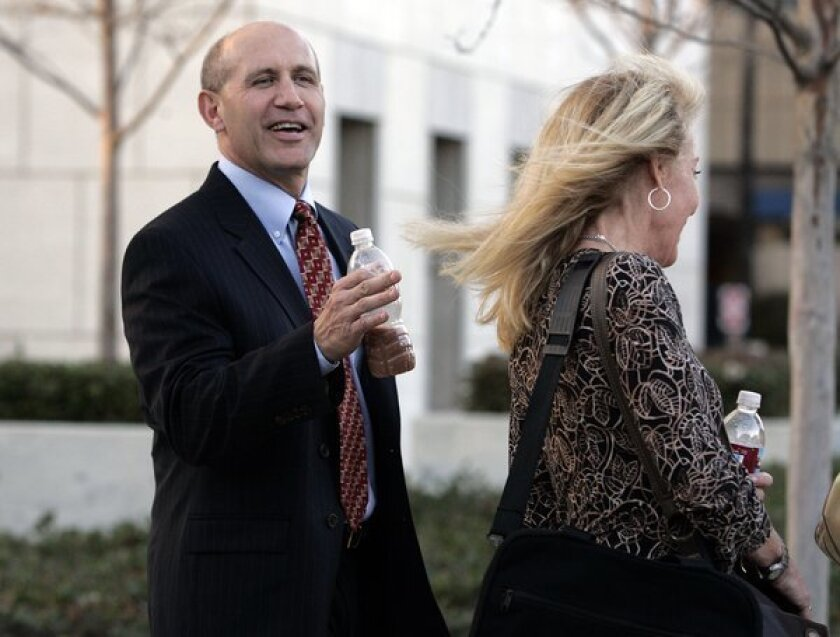Former Orange County Sheriff Michael Carona and his wife, Deborah, arrive at the Ronald Reagan Federal Building and United States Courthouse in Santa Ana during his trial in 2009.