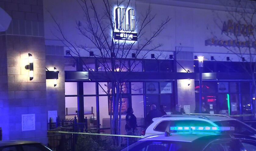 In this image from video provided by WSB-TV, police officers stand outside Old Lady Gang restaurant Friday, Feb. 14, 2020, in East Point, Ga.