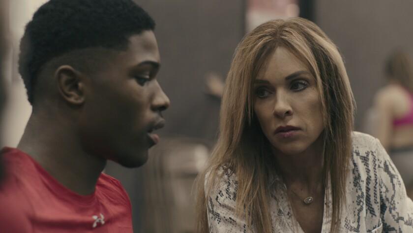 "La'Darius Marshall and coach Monica Aldama in the Netflix series ""Cheer."""