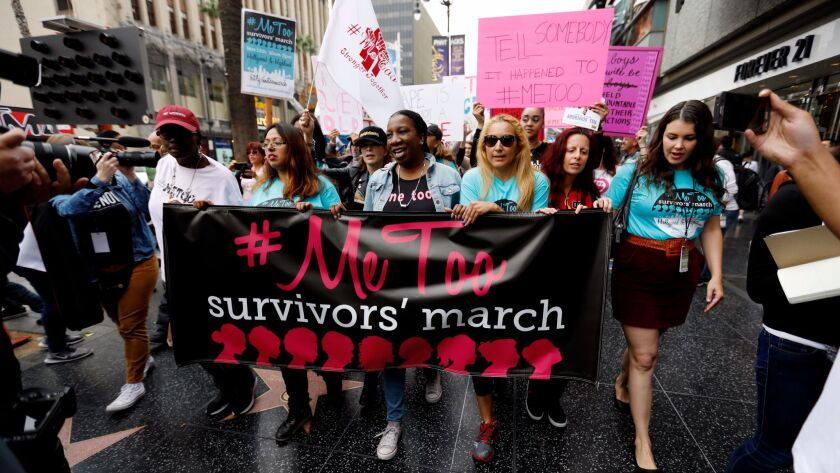 Sexual assault survivors along with their supporters protest in Hollywood on Nov. 12.