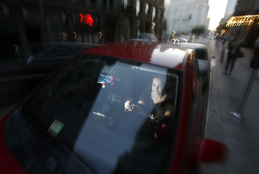Ruth Grayson is a driver for the ridesharing service Lyft. Lyft and similar companies such as Uber are working to kill a California insurance bill backed by insurers and taxi firms.